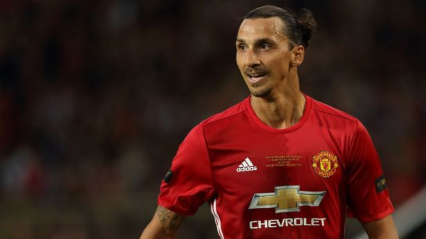 Manchester United and Swedish international Zlatan Ibrahimovic looks on to his teammates