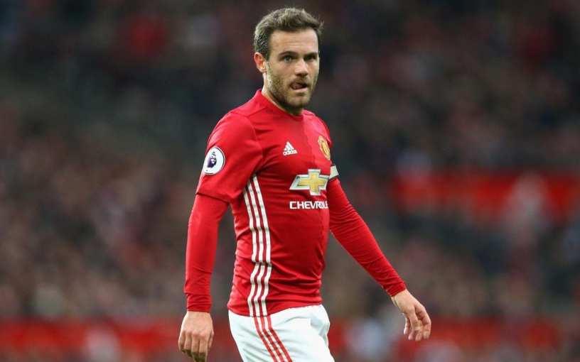 Manchester United and Spain international, Juan Mata looks on