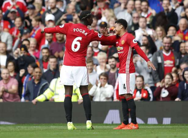 Manchester United youth products Paul Pogba and Jesse Lingard celebrate a goal together