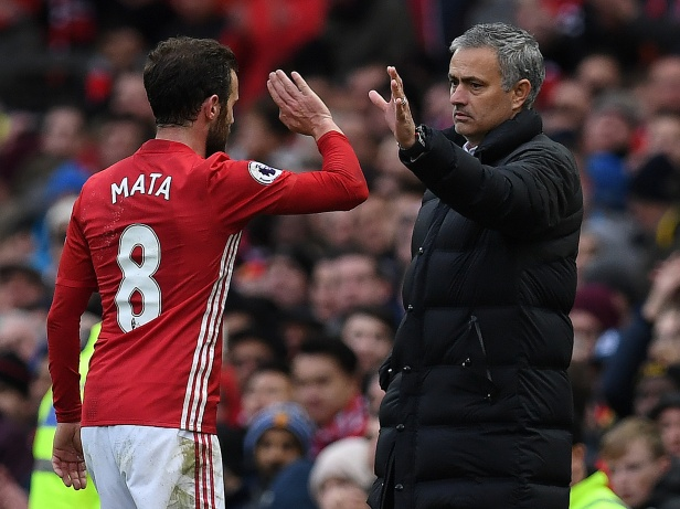 Manchester United's Jose Mourinho and Manchester United shake hands