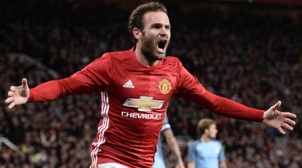 Manchester United's Juan Mata celebrates a goal