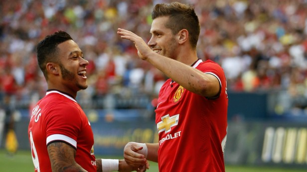 Manchester United's Morgan Schneiderlin and Memphis Depay celebrate together