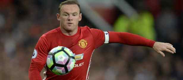 Manchester United and England captain Wayne Rooney looks to control the ball